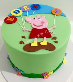 Peppa Pig birthday cake. Inside is a buttercake with layer of strawberry buttercream.