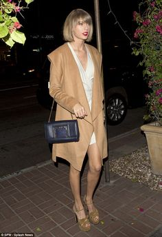 Looking great! Taylor Swift kept up with appearances on Monday night as she stepped out in...