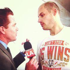Kent French interviews Ryan Getzlaf in his Violent Gentlemen locker room tee after the Anaheim Ducks shut out the Detroit RedWigs game 3