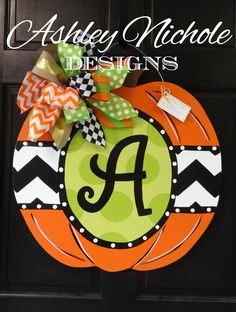 Initial Green Dot Fall Pumpkin Door Hanger by DesignsAshleyNichole Halloween Door Hangers, Fall Door Hangers, Burlap Door Hangers, Wooden Pumpkins, Fall Pumpkins, Pumpkin Door Hanger, Wooden Cutouts, Green Dot, Painted Doors
