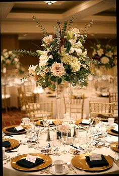 LOVE how the flowers look like their floating. You could have a tall centerpiece but still be able to see through them!