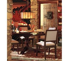 Showing rug with chocolate brown wood to represent chocolate brown leather Franklin Persian-Style Rug | Pottery Barn