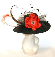 I want an embelished Derby hat one of these years... or take my black one and embelish it myself with feathers and flowers like this
