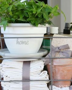 DIY hostess/housewarming gift basket – Whitewash a terracotta pot and add a holiday message... makes a pretty & practical gift basket.