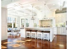 This image appealed to me because of all the hoizontal lines on the wood flooring, cabinetry and tile blacksplash. It all ties in so nicely and has really great flow. Also when I look at this, my eye is tempted to veer to the left at all the natural light coming in and adding brightness and welcoming me into the space