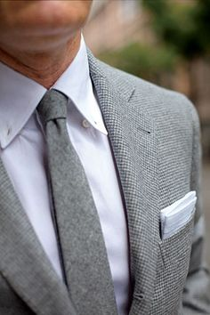 Grey tweed jacket, white shirt. Nice... a bright tie and matching printed square would make the outfit
