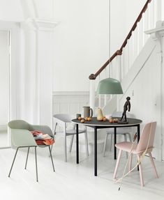 Scandinavian dining room interior inspiration from Muuto: The Fiber Armchair is made from an innovative wood fiber composite with up to wood fibers for a tactile expression and matte touch.