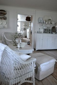 Symmetric rattan chairs form a cosy sitting corner. Utilitarian art