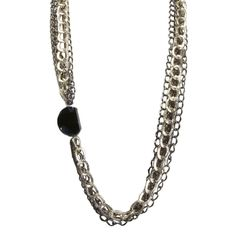 "You've got to mix it up to keep things interesting! The Shweta Necklace emphasizes form and space with its mixed metal chains, fancy S-hook clasp and variegated black agate stone. Wear Shweta and you'll never have a dull moment.   - 34"" long  - Mixed metals chain with natural Botswana faceted agate. Jewelry.AvaMidori.com"