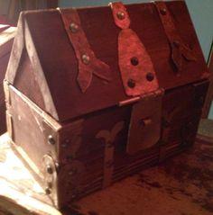 brass furnishing on wood coffer box.