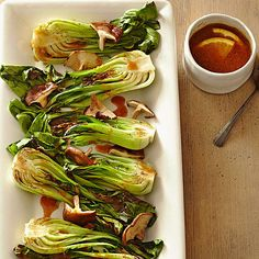 Broiled Bok Choy with Miso Sauce is a low-calorie side with seriously original flavor. Rice wine, miso paste, and ginger lend their bold Asian flavors to this so-easy dish. More farmer's market recipes: http://www.bhg.com/recipes/seasonal/heart-healthy-recipes-from-the-farmers-market/ #myplate