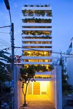 Stacking Green by Vo Trong Nghia. A dozen layers of concrete planters create a vertical garden on the facade. Concrete Architecture, Green Architecture, Amazing Architecture, Futuristic Architecture, Sustainable Architecture, Terrain Constructible, Dubai Miracle Garden, Green Facade, Magic Garden