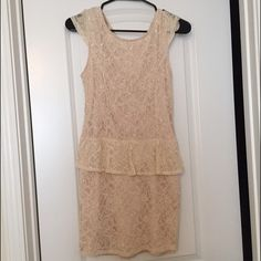 SALE‼️‼️Elegant cream colored dress! Small and well fitted dress. It is Lacey but not see through! It is great for going out or dressing up. Poof! Dresses Mini
