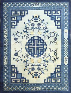 Early 20th century blue and white antique Chinese Peking rug with geometric lattice pattern. Floral and foliage design in the center. Circa 1920.