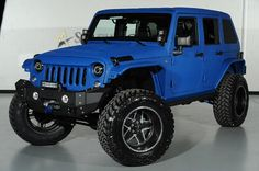 2014 Jeep Wrangler Unlimted with Kevlar Liner Finish in Laguna Seca Blue: Front-Left View