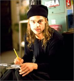 Brad Pitt in 12 Monkeys. This is my favorite role for him. He  made this movie great.