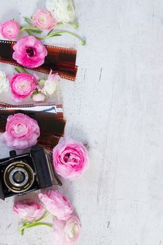 Old camera and ranunculus flowers by Neirfy on @creativemarket