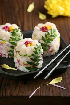 Flower Sushi - rice, sushi vinegar, pickled chrysanthemum petals, scallop sashimi, cucumber, sesame seeds, and kinome leaves