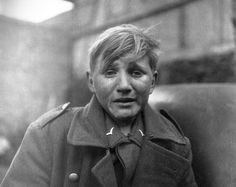 Especially to Germans, this is one of the war's most iconic pictures. Hans-Georg Henke was a 15 year old member of a flak squad who burst into tears upon his surrender. His father died 1938 and his mother in 1944, so he joined the Luftwaffe to support himself. In the spring of 1945, he walked 60 miles to reach American lines in Rechtenbach. His two brothers also survived the war, and he spent his postwar life in East Germany. He died in Finsterwalde in 1997. Photo by John Florea (April 3…