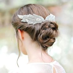This chic winged headdress will sit beautifully on the back of your head with either an up-do or a long, loose hairstyle. This design - from wedding hair accessories doyenne Donna Crain - can be personalised or adapted to suit your taste, but this classic style works beautifully with a lace wedding dress. #weddinghair #hairaccessories #wedding #hair #jewellery #jewelry #haircomb #hairband #hairpins #tiara #headdress #weddingoutfit #bridalhair #bride #DonnaCrain
