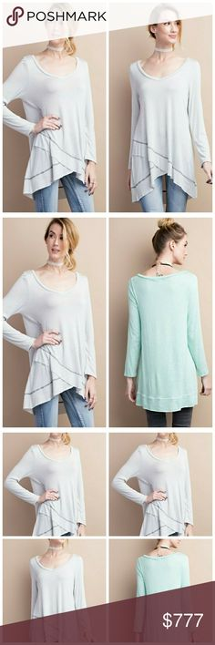 Arrives today! Like to be notified! Super soft and light long sleeve hi-low hem overlay, deep v-neck tunic. Photo of the back of the tunic is not the same color as one on sale. All other photos are of exact color which is light grey. 95% rayon, 5% spandex.   Definetely a versatile wardrobe staple piece! $35. Like to be notified! Tops Tunics