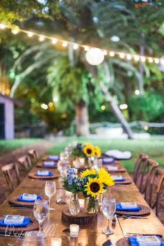 Sunflower farm tablescape by Love In Bloom Florist Key West at the Hemingway House. Photo Megan Ellis Photography