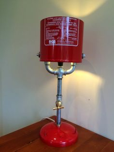 Rate this from 1 to Fire Extinguisher Midcentury Modern Interiors We Love Putting out fires with our DIY fire extinguishers! Bicycle parts desk lamp by Cool Lamps, Unique Lamps, Lamp Light, Light Up, Recycled Lamp, Luminaire Vintage, Industrial Lighting, Industrial Chic, Pipe Lamp