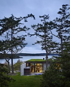 Concrete house by Olson Kundig Architects cuts into a rocky outcrop...