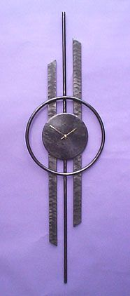 Wall Clocks in forged steel, original contemporary designs