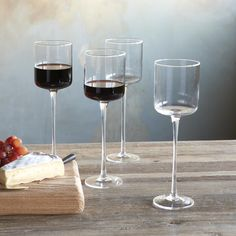 GALA WINE GLASSES, SET OF 4--The toast of any well-dressed table, our long-stemmed beauties of mouth-blown glass are a crisp, modern way to ring in holidays, special occasions or fêtes accompli. Set of 4. 12 oz.