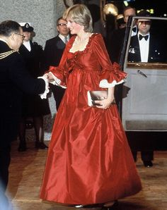 A pregnant Princess Diana, Princess of Wales in a red David Sassoon maternity gown attending a function at the Barbican Centre on March 1982 in London. Get premium, high resolution news photos at Getty Images Princesa Diana, Princesa Real, Princess Diana Fashion, Princess Diana Pictures, Red Maternity Dress, Maternity Fashion, Maternity Style, Only Fashion, Royal Fashion