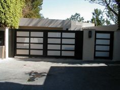 """Model: Entry Gate and Double Driveway Gate, Size: Gate: 3'6″ x 6′ Driveway Gate: 15'6″ x 6′ Frame: Powder Coated: Bronze Glass: 1/4"""" Laminated Obscured: Bronze Location: West Hollywood, CA"""