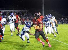 Seaside 12, MVC 7. Seaside High School quarterback Michael Turner runs for short yardage against Monte Vista Christian's defense during Friday night's battle of undefeated teams in Seaside. / Jay Dunn/The Salinas Californian