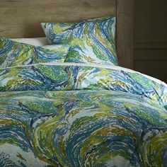 New wave. Painterly brushstrokes wash over The Oasis Duvet in a swirl of cool color. The hand-screened pattern is inspired by the ocean.