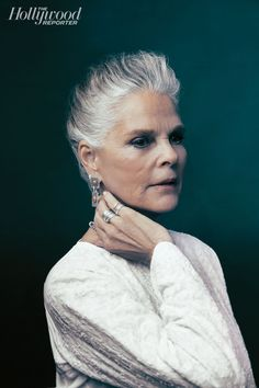 Ali MacGraw My own hair is silver and curly, and I love it it.  It's my trademark:  no one is touching it!