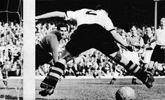 28th January 1956. With Aston Villa goalkeeper Keith Jones beaten, full back Stan Lynn misjudges the shot from an Arsenal player as it goes through his legs and just wide of the post, at Highbury.