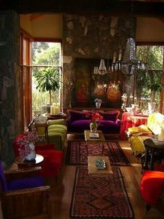 Absolute perfection! That violet (what looks to be velvet -Love!-) couch, scrumptious! Next to the lime green couch, nailed it!