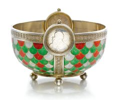 A Fabergé silver and enamel bowl, workmaster Anders Nevalainen, St Petersburg, 1899-1903, the outer surface with scales of translucent green, red and white enamel over sunburst engine-turning, the rim set with two rouble coins, entrelac borders, four ball feet.