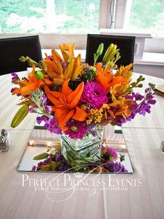 #orange #purple #centerpiece #wedding designed by Perfect Princess Events