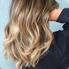 Shades of ashy blonde and honey What to ask for: For this look, ask for balayage and take photos to explain what's in your head.
