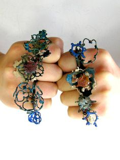Rings | Mairi Collins.  In silver, steel, iron, patinated/enamelled copper and bronze. And coral too.
