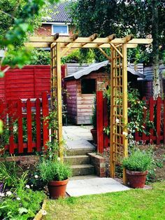 Natural finished arbor and RED picket fence