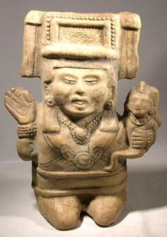 Figure of a Mesoamerican mother and child with filed teeth. Posted on mexicanfood1.wordpress.com.