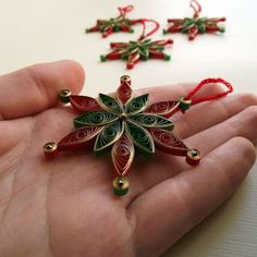 This red and green quilled snowflake is included in a round up of fifteen handcrafted tree ornaments made of paper. Diy Quilling, Paper Quilling Patterns, Quilled Paper Art, Quilling Paper Craft, Paper Crafts Origami, Paper Christmas Decorations, Paper Christmas Ornaments, Quilling Christmas, Diy Christmas