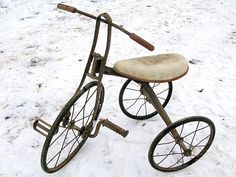an old, iron tricycle (with an upgrade, a much newer seat)