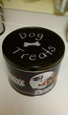 Old popcorn tin reborn.  I painted the top with chalkboard paint and now keep the dog treats inside.