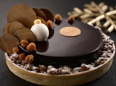 A PIE FOR CHRISTMAS | Mandarin Oriental Singapore | Sink your teeth into this luscious chocolate wonderland, or what Mandarin Oriental calls, the Christmas Chocolate Mixed Nuts Crunch Pie ($36). The pie is a combination ofchocolate ganache with mixed nuts crunch laid atop a crust of exquisitely-baked vanilla sable tart. Thiscreation would be a great option to finish off any festive meal and it comfortably serves five persons. Available until 25 December at Mandarin Oriental's festive ...