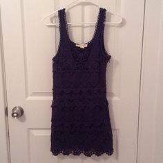 Staring at Stars UO navy, eyelet dress Size XS. Shell: 100% cotton. Lining: 100% polyester. Dry clean only. Zipper on side of dress. In excellent condition! Feel free to ask me any questions Urban Outfitters Dresses