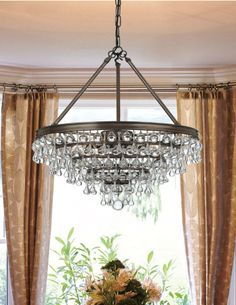 We carry this Crystorama chandelier available in Vibrant Bronze of Polished Chrome. It has cascading glass balls and teardrops to add elegance to any space. Dining Chandelier, Bronze Chandelier, Chandelier Lighting, Crystal Chandeliers, Clear Crystal, Clear Glass, Light In, Pergola With Roof, Lighting Store