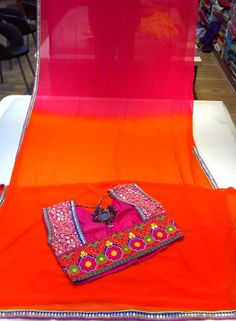 ohhh my my...I am in love with this sari and blouse! Rich pretty colors and so stylish blouse! awesome!